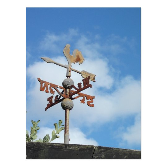 Rusty Weathervane against blue sky Postcard