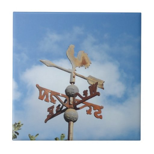 Rusty Weathervane against blue sky Small Square Tile