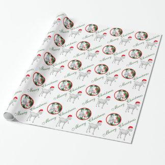Saanen y papel de embalaje del navidad de la cabra