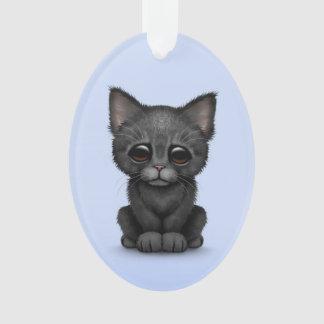 Sad Cute Black Kitten Cat on Blue