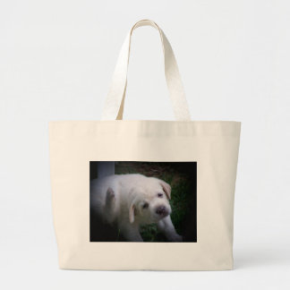 sad eyes large tote bag
