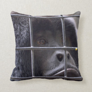 sad monkey in cage primate image throw pillow