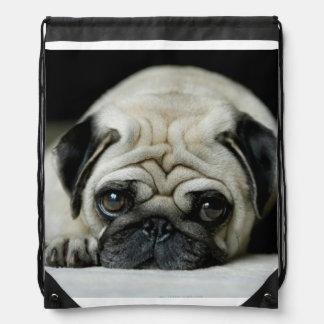 Sad pug - dog lying down - dog look - cute puppies drawstring backpack