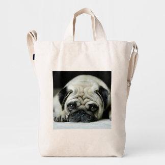 Sad pug - dog lying down - dog look - cute puppies duck bag