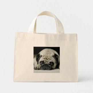Sad pug - dog lying down - dog look - cute puppies mini tote bag