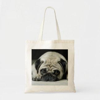 Sad pug - dog lying down - dog look - cute puppies tote bag
