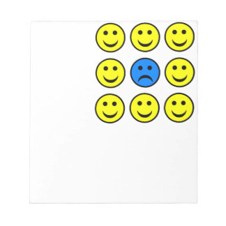 Sad Smiley Face in a Crowd of Happy Smilies Note Pad