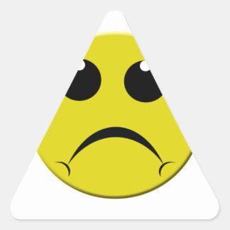sad smiley face triangle sticker