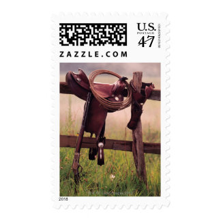 Saddle and lasso on fence stamp