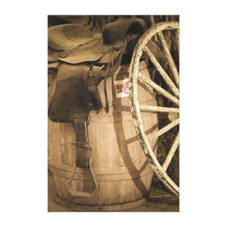 Saddle, Barrel, and Wagon Wheel Canvas Print