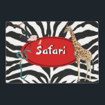 """Safari Placemat<br><div class=""""desc"""">""""Safari"""" is printed in fun white lettering across a bright red oval with a black border on zebra print. An impish black monkey, stately giraffe, and foreboding green snake add excitement to this 12"""" x 18"""" paper placemat. See matching cloth placemat, cloth napkin, paper cocktail napkin and coasters. See the...</div>"""