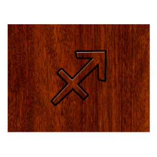 Sagittarius Zodiac Symbol on Mahogany Wood Decor Postcard