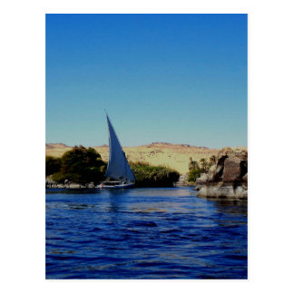 Sail boat on the blue Nile in Egypt photo Postcard