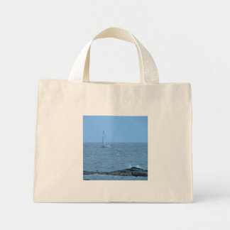 Sail boat with rocks mini tote bag