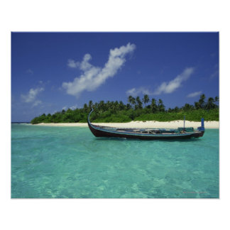 Sailboat in tropical water by beach poster