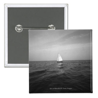 Sailboat on ocean button