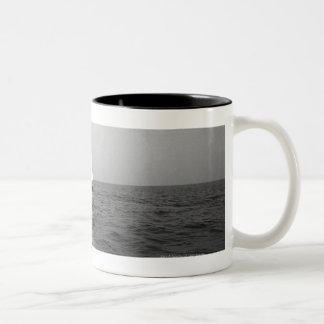 Sailboat on ocean Two-Tone coffee mug