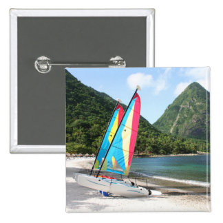 Sailing Boat and water sports equipment on a beach Button