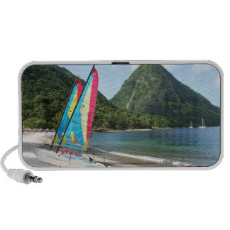 Sailing Boat and water sports equipment on a beach Speaker
