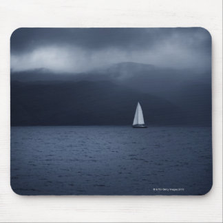 Sailing boat in stormy weather in Scottish Mousepads