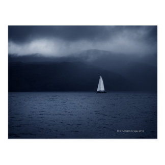 Sailing boat in stormy weather in Scottish Postcard