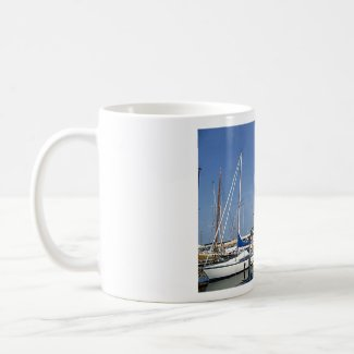 Sailing boats in the harbour mug