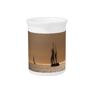 Sailing boats on shore of the Baltic Sea Beverage Pitcher