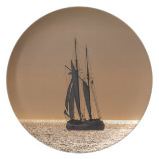 Sailing boats on shore of the Baltic Sea Plate