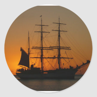 Sailing ship in the sea ,sunset classic round sticker