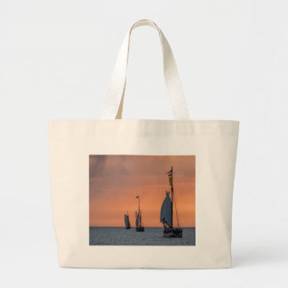Sailing ships in sunset light on the Baltic Sea Large Tote Bag