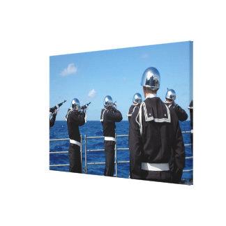 Sailors fire a gun salute during a burial-at-se canvas print