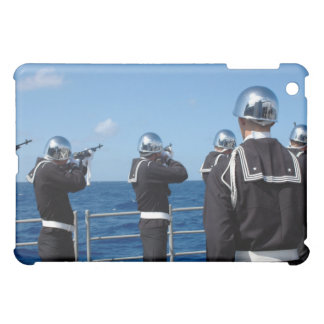 Sailors fire a gun salute during a burial-at-se case for the iPad mini
