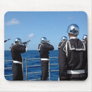 Sailors fire a gun salute during a burial-at-se mouse pad