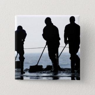 Sailors sweep out the hangar bay pinback button