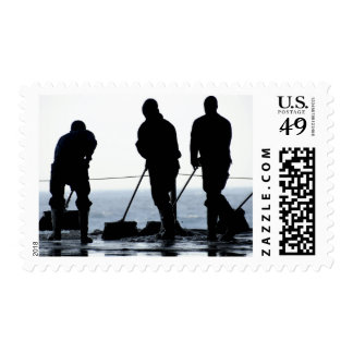 Sailors sweep out the hangar bay stamp