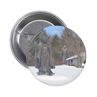 Saint in the snow statue 2 inch round button