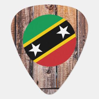 Saint Kitts and Nevis flag circle on wood backgrou Pick
