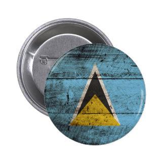 Saint Lucia Flag on Old Wood Grain Pinback Button