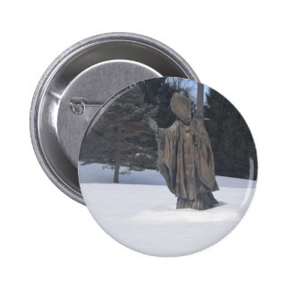 Saint pushing through the snow 2 inch round button