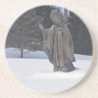 Saint pushing through the snow coasters