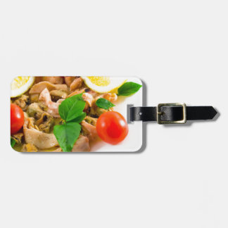 Salad of blanched pieces of seafood on a plate bag tag