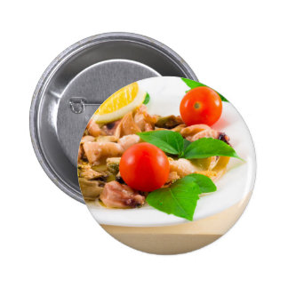 Salad of blanched pieces of seafood on a plate button