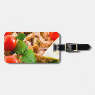 Salad of blanched pieces of seafood on a plate luggage tag