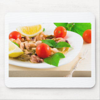 Salad of blanched pieces of seafood on a plate mouse pad