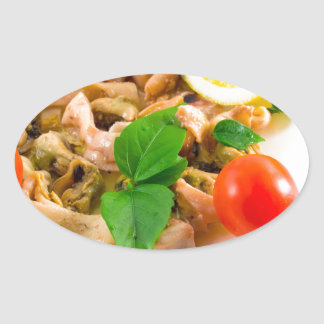 Salad of blanched pieces of seafood on a plate oval sticker