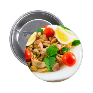 Salad of blanched pieces of seafood on a plate pinback button