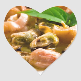 Salad of blanched seafood on a white plate heart sticker