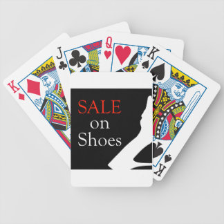 Sale on shoes with silhouette of a shoe bicycle playing cards