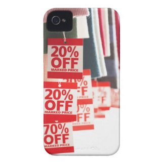 Sale tags attached to hanging clothes, close-up iPhone 4 covers
