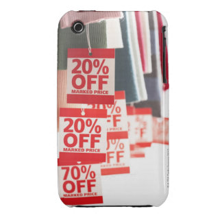 Sale tags attached to hanging clothes, close-up iPhone 3 covers